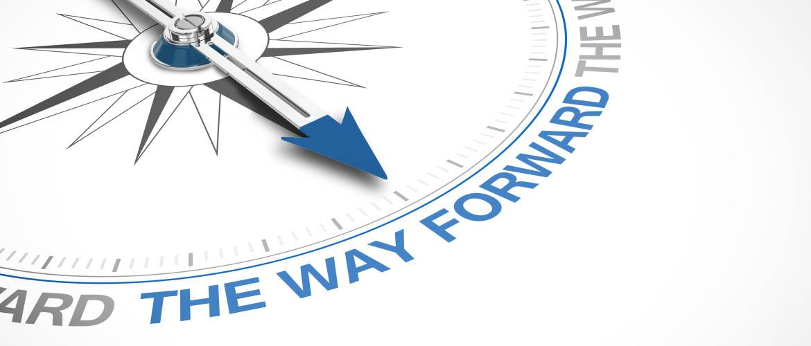 Compass pointing to 'the way forward' text